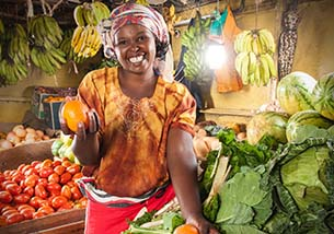 women holding fruit with a solar light behind her